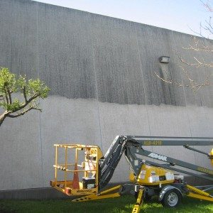 Removing black weathering from concrete building