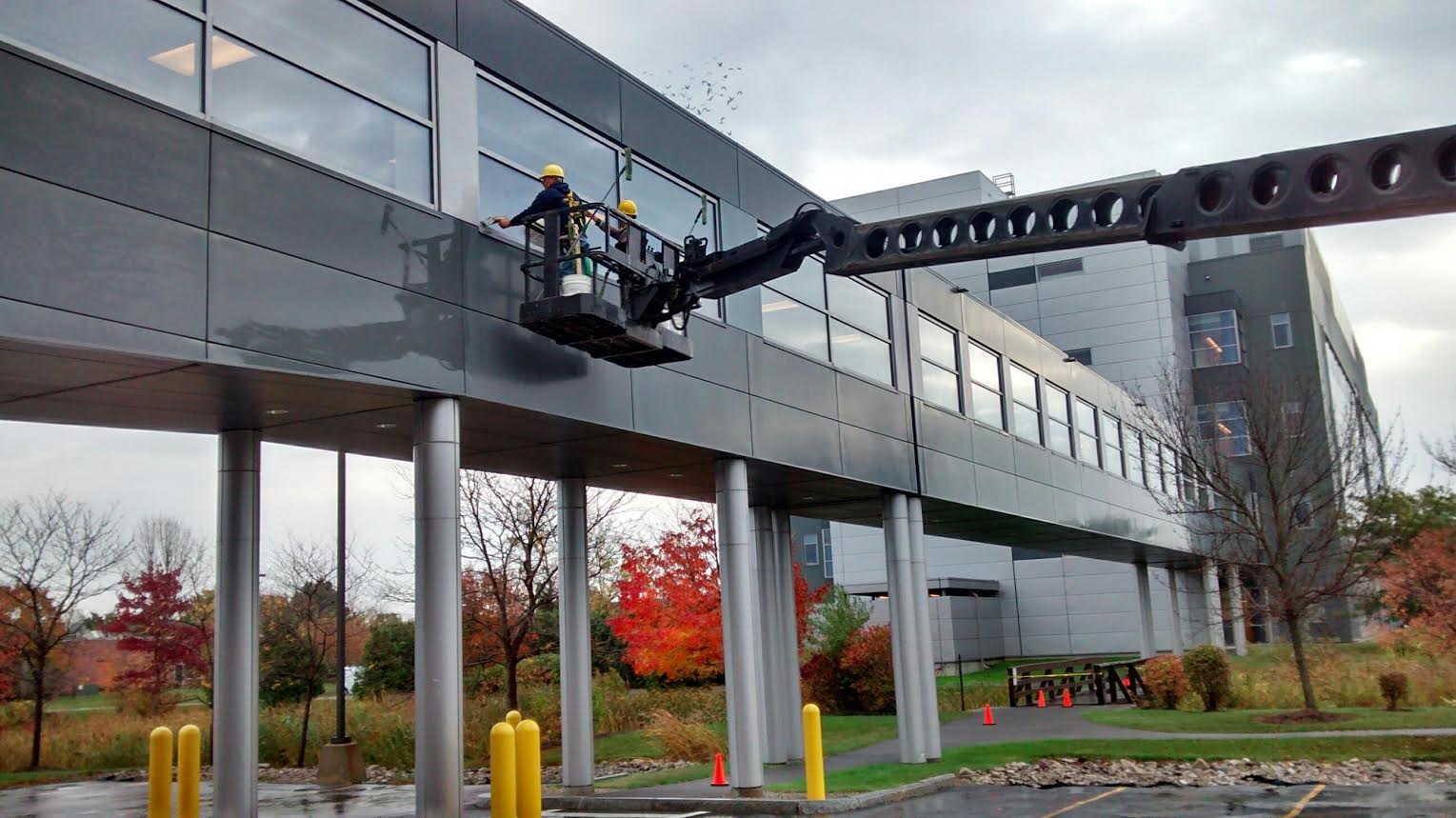 Window Cleaning on a pedestrian bridge that spans a canal.
